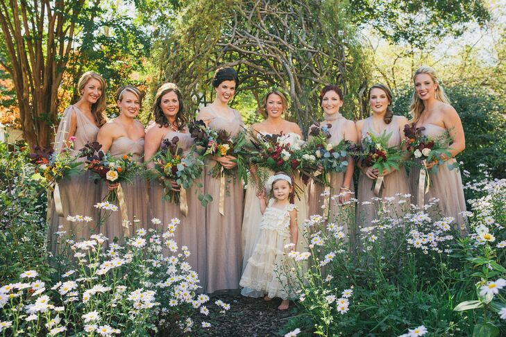 """""""I knew I wanted a long dress, but I also wanted it to be flowy since the wedding ceremony was outside. It was also important for me to choose something that was comfortable and could fit all shapes and sizes,"""" Kelley says. The flower girl wore an Etsy dress similar to the bride's."""