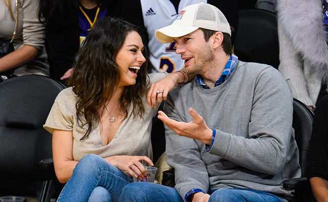 Mila Kunis and Ashton Kutcher at a basketball game