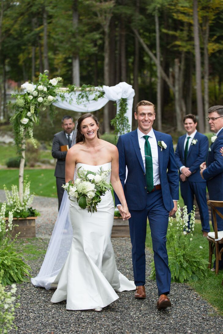 Traditional Couple in Simple Strapless Dress and Classic Blue Suit
