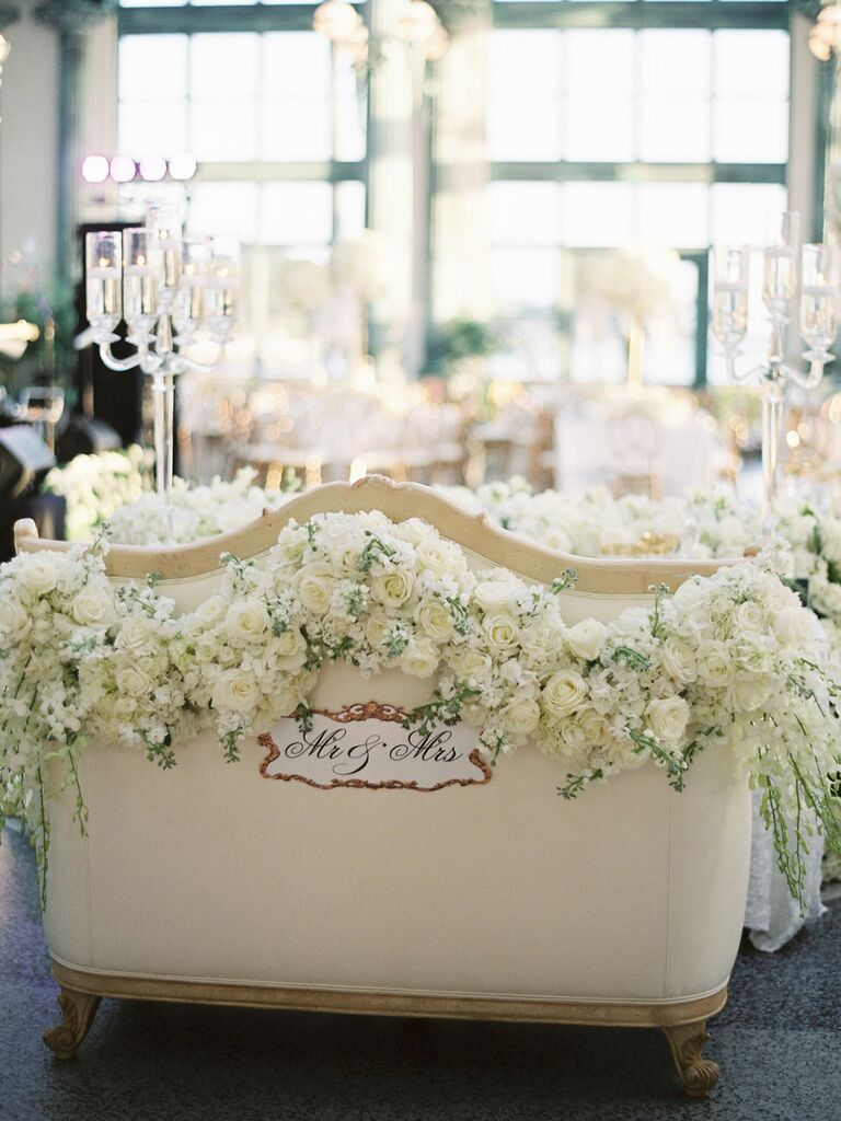 Mr. and Mrs. sweetheart seat with monochrome white flowers at regencycore wedding