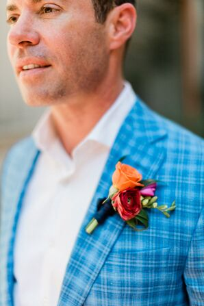 Groom in a Blue Plaid Suit Jacket with an Orange Boutonniere