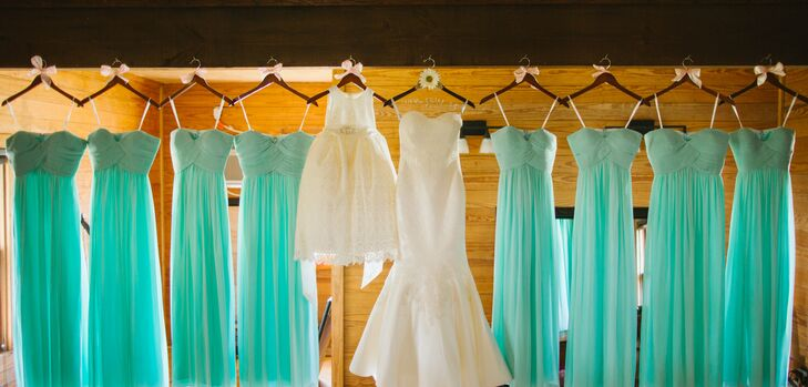 The eight bridesmaids wore floor-length, mint green chiffon dresses by Donna Morgan.