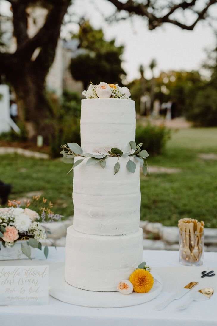 Emily made the three-tier wedding cake, decorating it with a few peach rose buds and bits of greenery.