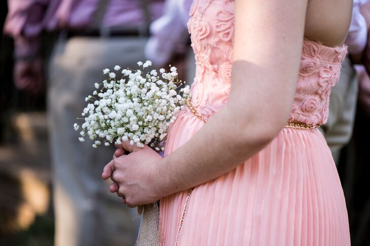 The bridesmaids wore different shades of pale pink dresses and carried homemade clusters of baby's breath.