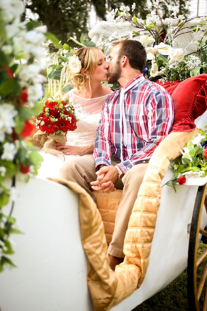 Ashley and Jason left their ceremony in a horse-drawn carriage overflowing with red and white Gerbera daisies, white calla lilies, red roses and greenery.