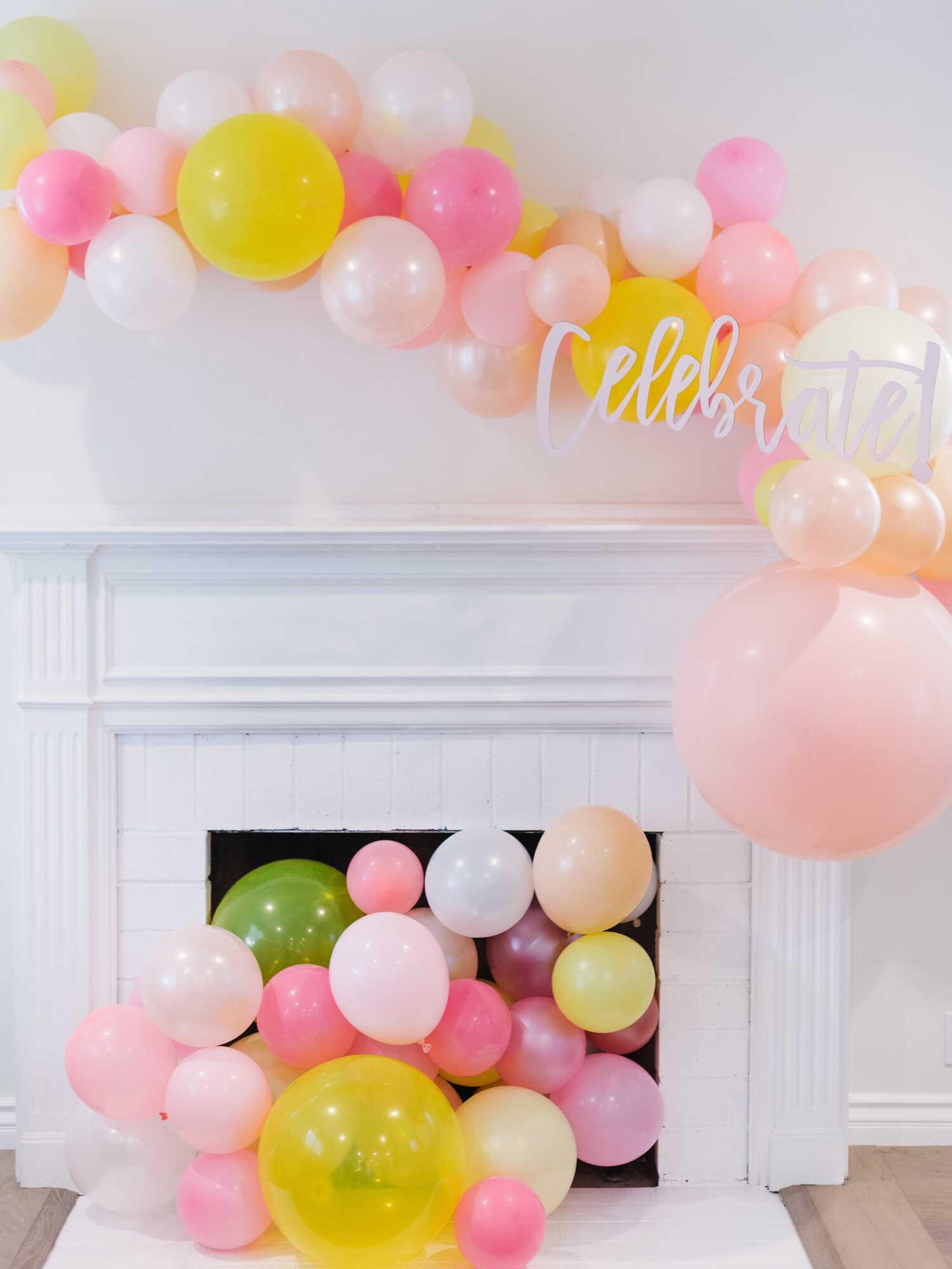 Yellow and pink balloon garland decor