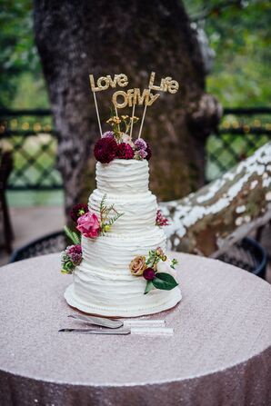 Four-Tier Cake with Flowers and Cake Topper