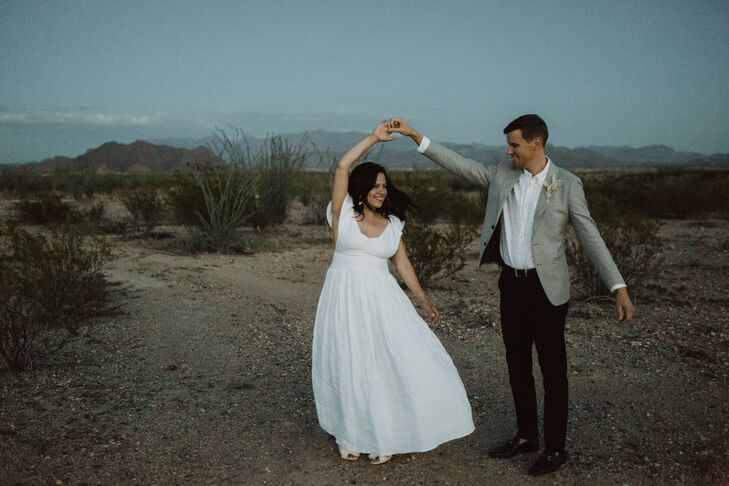 Casual Desert Couple with Bohemian Wedding Dress and Gray Suit Jacket