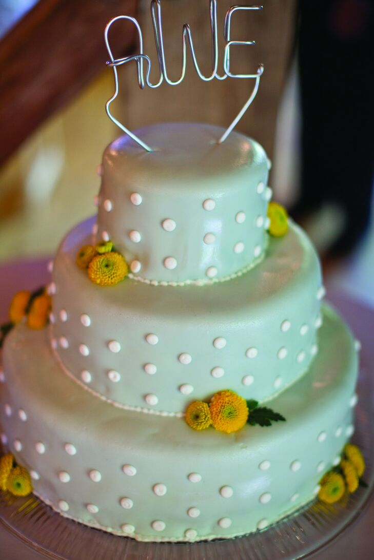 The gray-fondant cake was decorated with white dots, yellow flowers and a monogram cake topper.