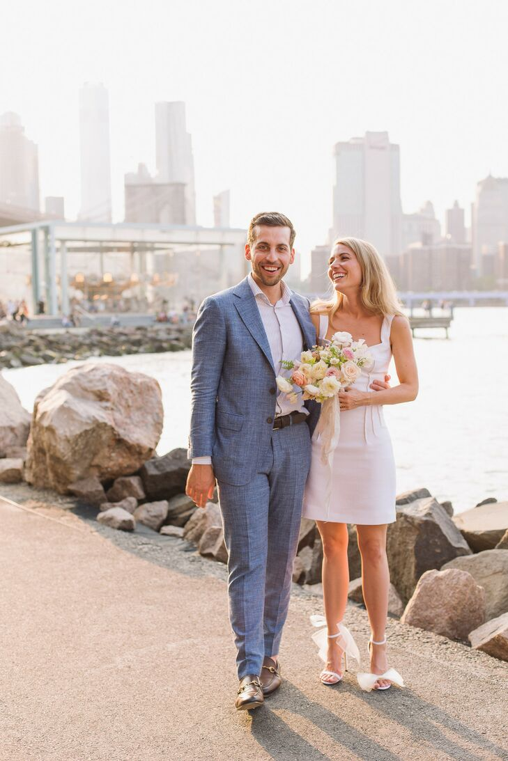 Modern Couple Wearing Gray Suit and Short Dress in New York City