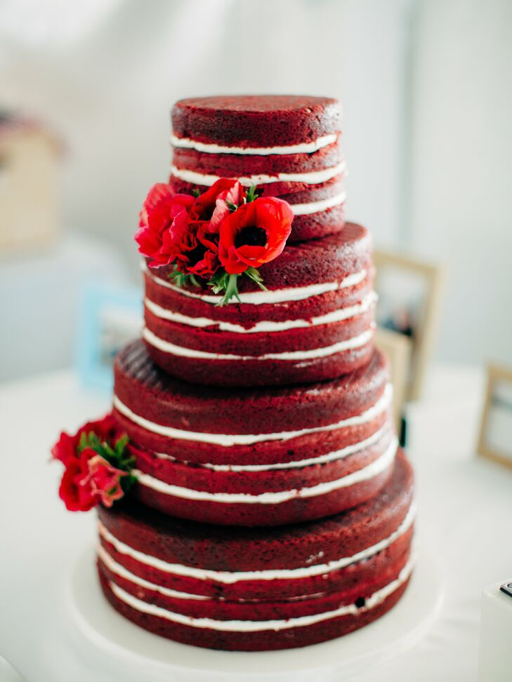 The perfect accent to a bold stripe wedding theme? A red velvet naked cake. Between rich layers of cake, white buttercream frosting and red flowers gave the cake a statement-making look.