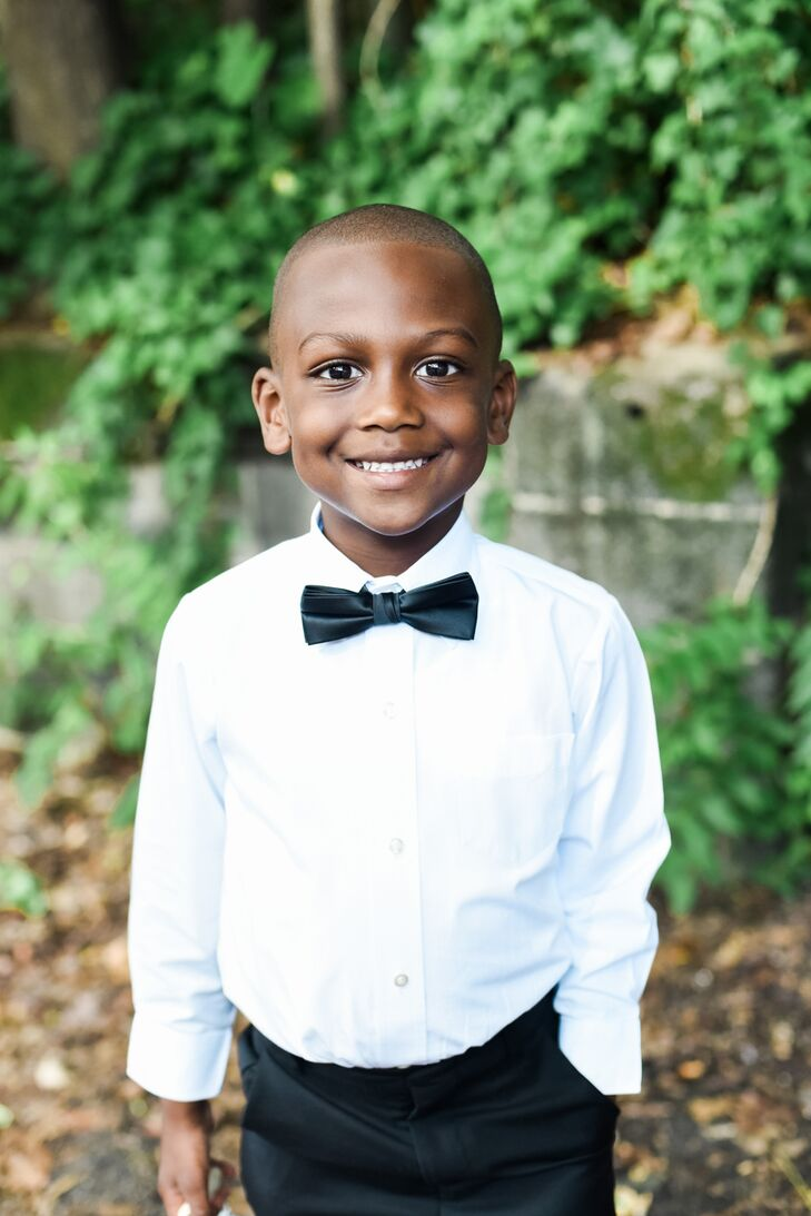 The couple's son, Mason, was the ring bearer and the best man. He wore a custom black suit outfitted with a black bow tie and black-and-white Converse All Star sneakers. He was the only groomsman in the wedding party.