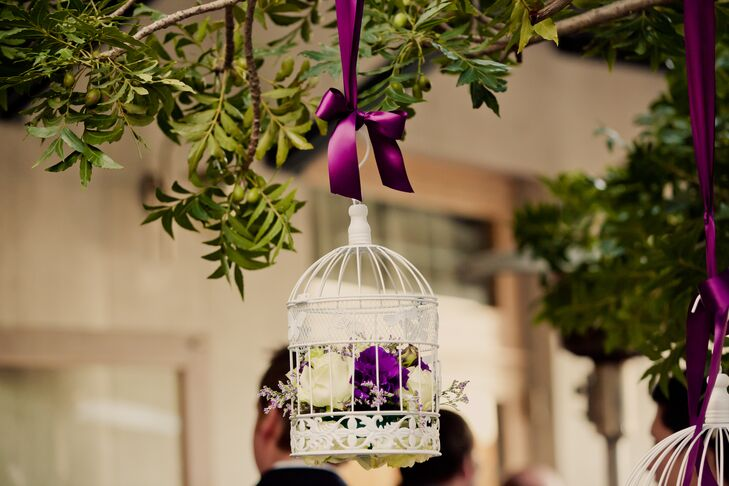 Hanging Bird Cages With Purple and White Roses
