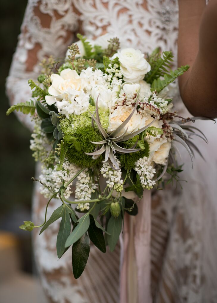 Olga is from Russia, where flowers have very specific meanings, so she carefully selected only those with positive significance. Her oversize bouquet featured neutral blooms and cascading greenery with a refined organic texture.