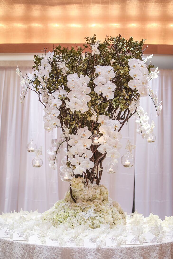 Tall Centerpiece with White Orchids and Votives