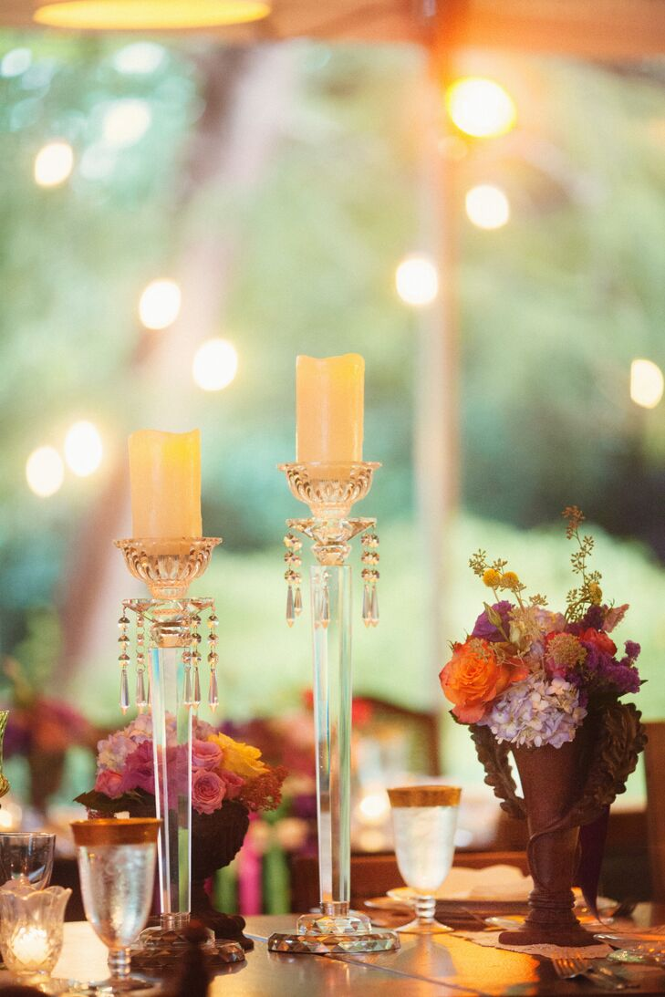 Annie and Owen worked with their planner from Choreographed Events to set up romantic lighting. Tealight candles or tall crystal candlesticks with glam draped crystals were in every tablescape at the reception at Marie Selby Gardens in Sarasota, Florida.