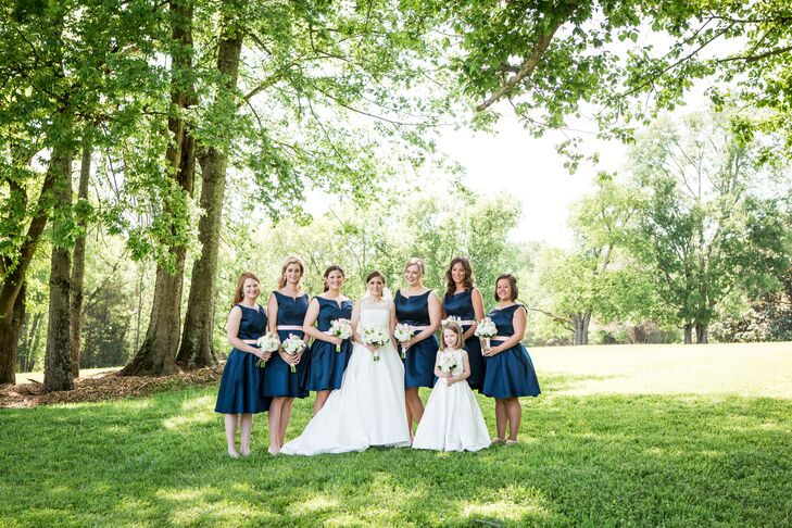 Kate wanted something fun yet preppy for her bridesmaids and decided on short navy dresses.
