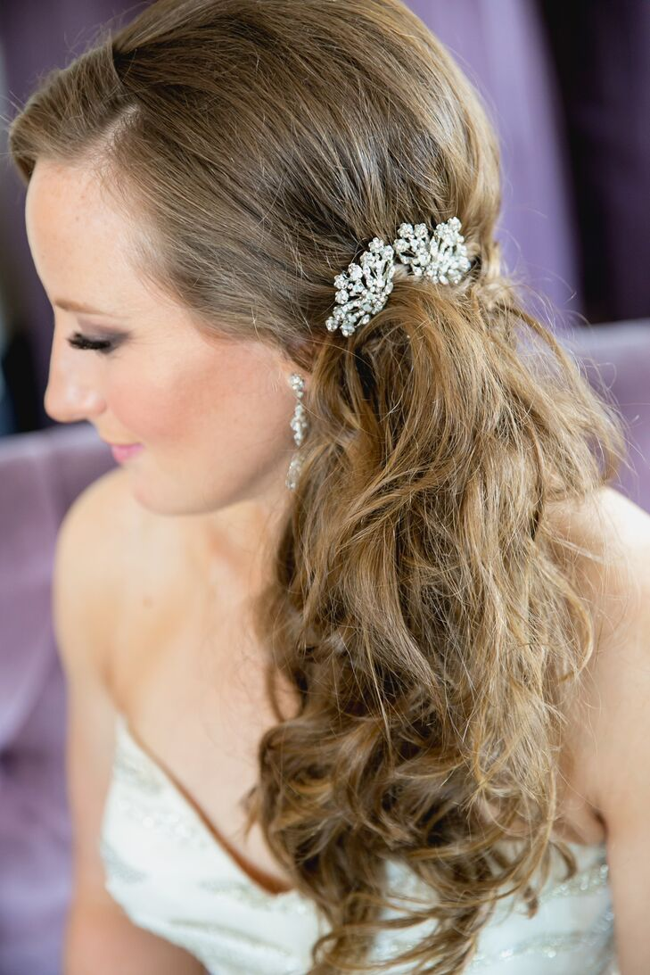 After the ceremony, Maura styled her hair into an elegant side ponytail for the rest of the evening. Her hair had a stylish crystal clip woven into the long curls.