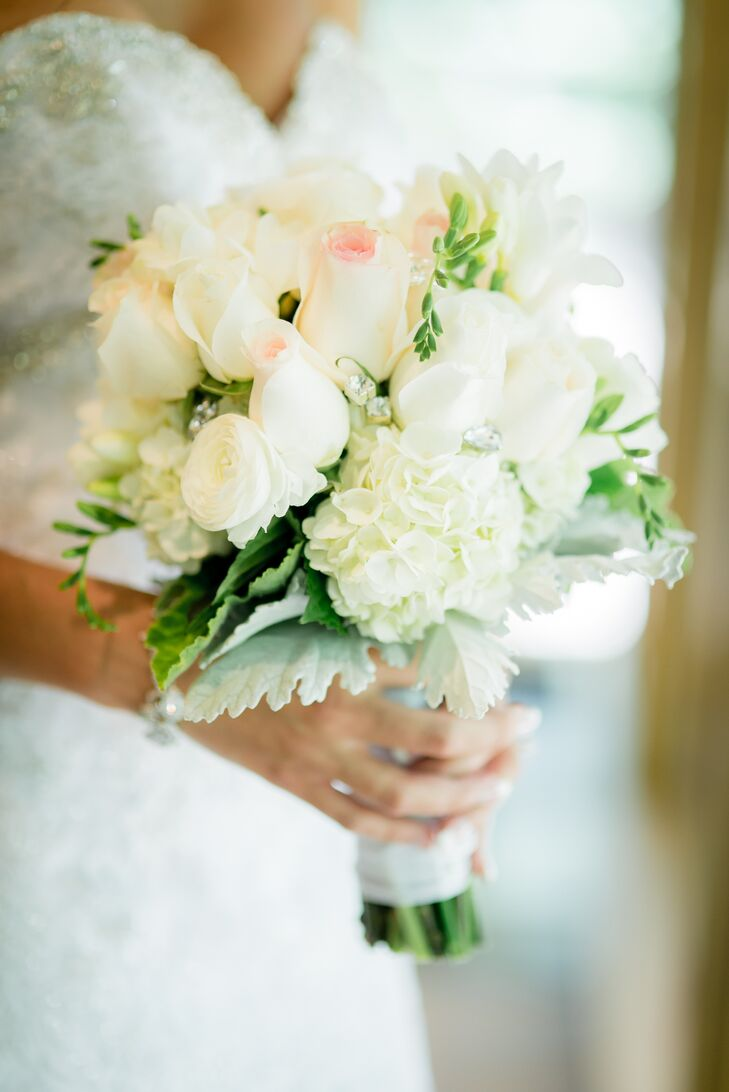 Melissa carried hydrangeas, roses, ranunculus and lamb's ear in her bouquet.