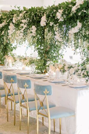 Romantic Tablescape With Hanging Greenery Centerpiece and Blue Velvet Chairs