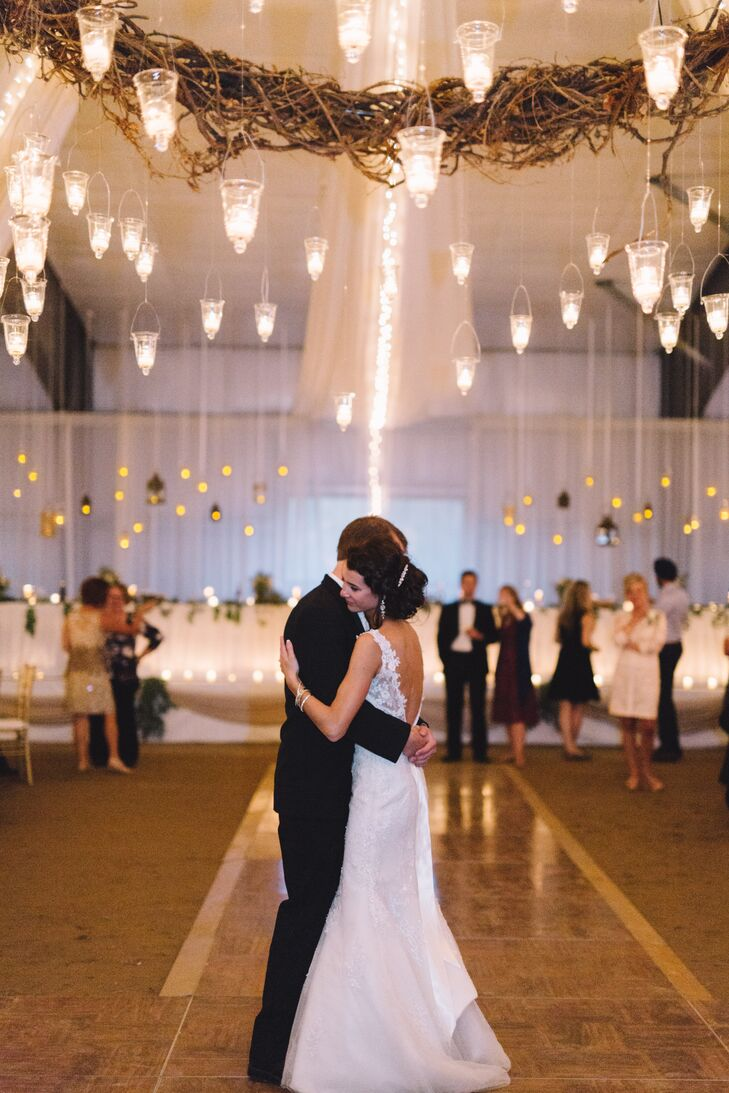 Oriana and Adam shared their first dance beneath the romantic glow of hanging votives.