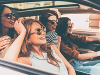 Girls wearing sunglasses and driving