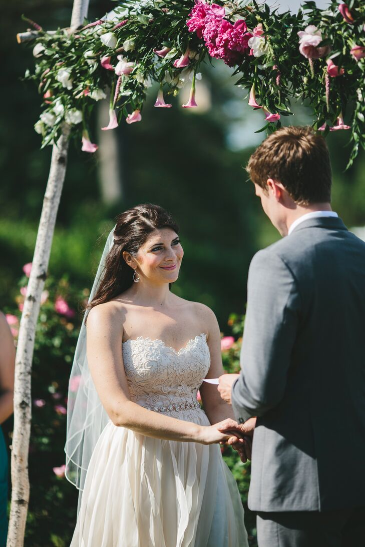 Dan created the chuppah for the ceremony, which took place outside at Jess's family home. He made the traditional structure with birch poles, decorated with pink calla lilies, peonies, veronica and Italian ruscus that draped from above.