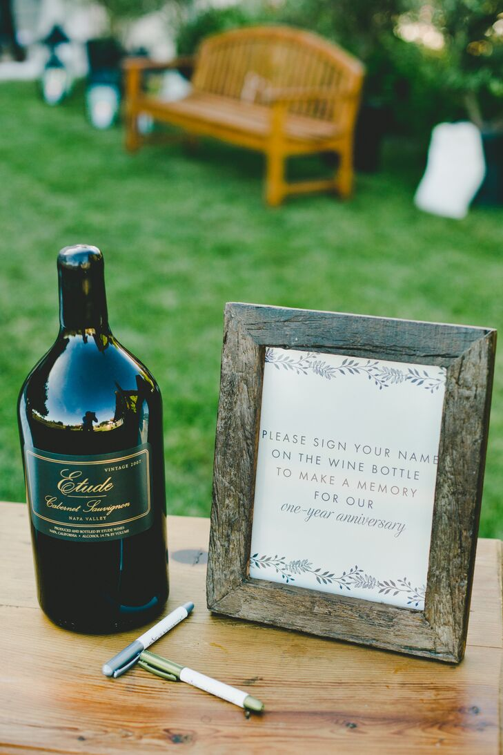 In lieu of a traditional guest book, Robyn and Tony invited their guests to share their well wishes on a bottle of Etude Winery cabernet, which they would drink on their one-year wedding anniversary.