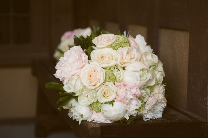 The bouquets were a soft, romantic mix of ivory and pink roses and peonies.