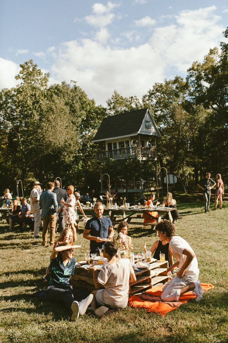 The reception took place in a field at the camp. Farm tables were interspersed with pallet tables for picnic-style hangouts.