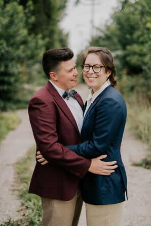 Couple Wearing Colorful Suits Shares Embrace