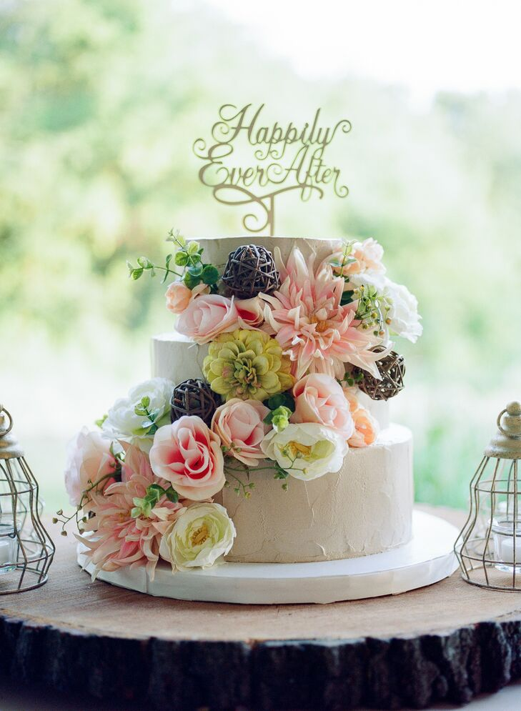 "The cannoli wedding cake was decorated in cascading blush and ivory flowers and a gold ""Happily ever after"" cake topper."