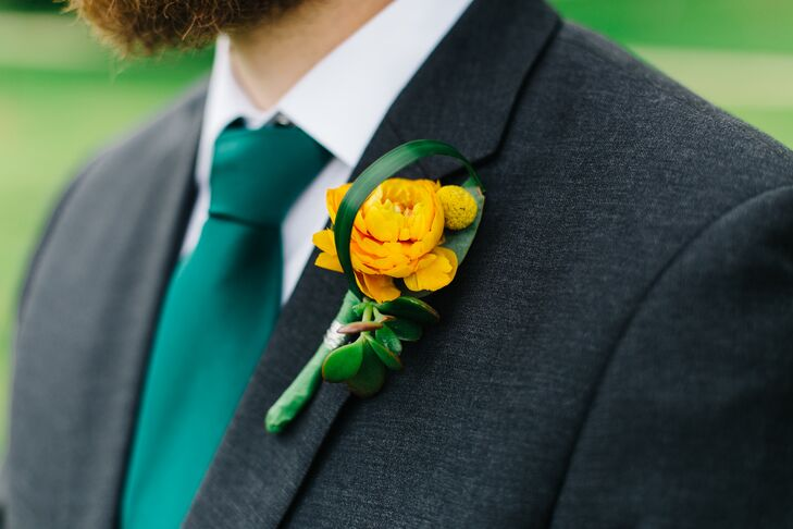 Orange Ranunculus Boutonniere with Yellow Craspedia