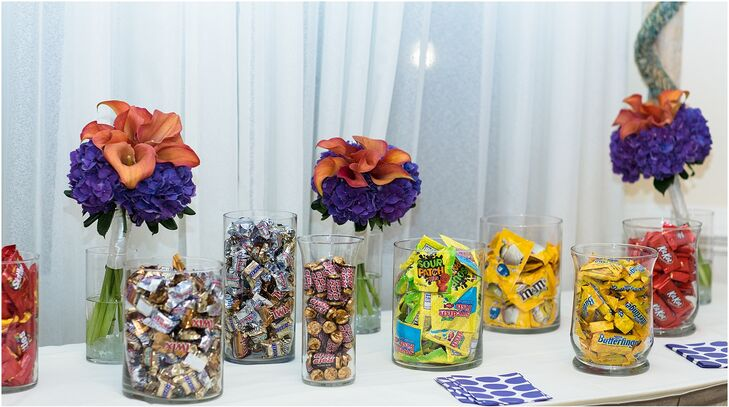 A candy bar with a variety of chocolates and assorted candies was set up for guests to take home.