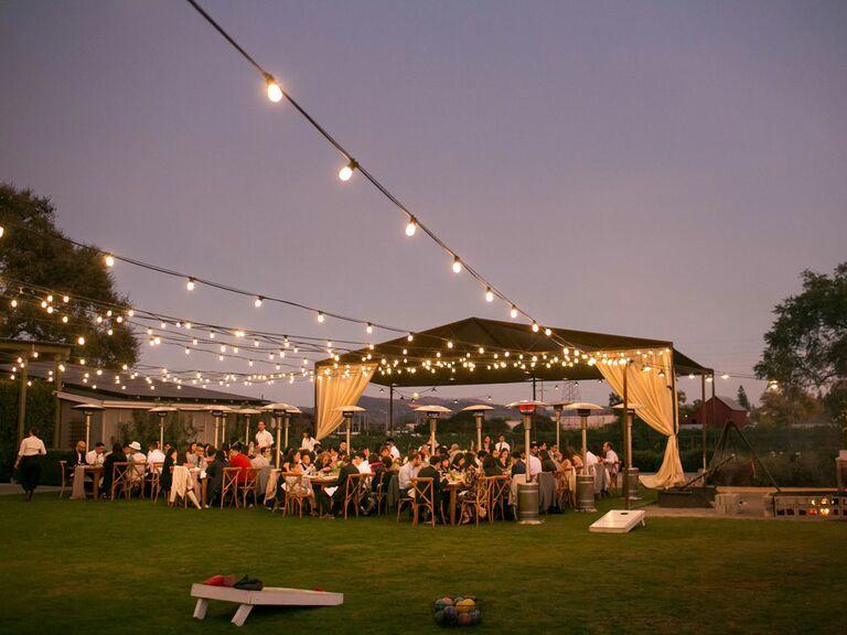 Rustic outdoor ranch wedding venue with string lights