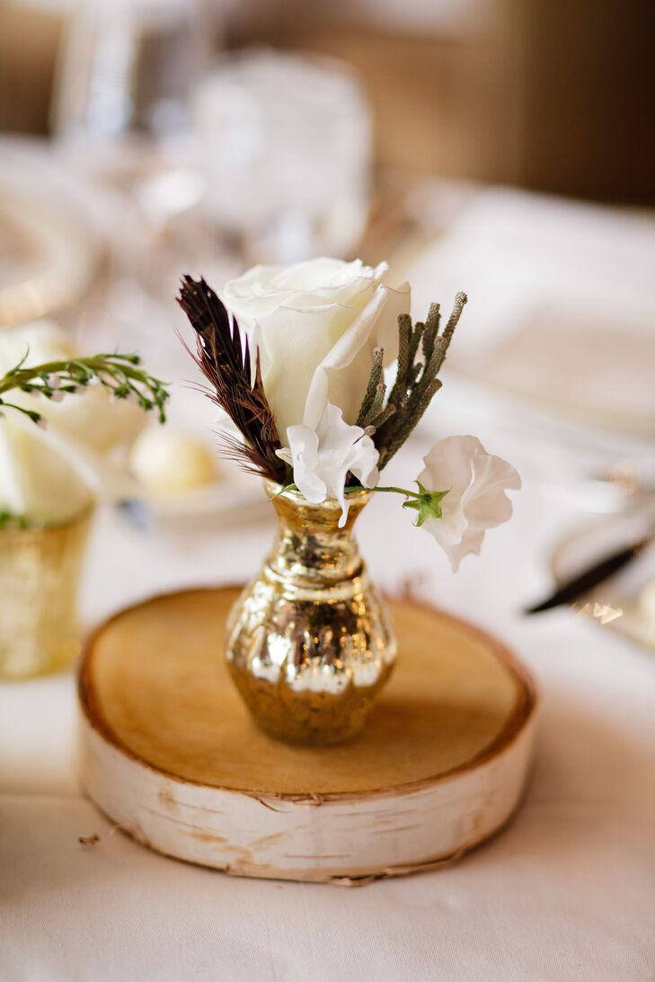 Feather and Wood Centerpiece With White Roses