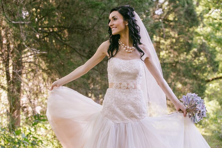 Ashley wore a Justin Alexander wedding gown with a fitted bodice and a cascading skirt of three shades of tulle.
