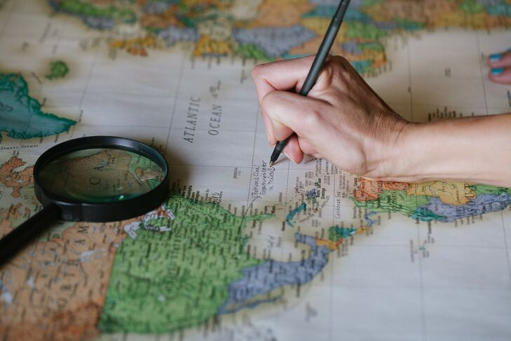 The guest book was a five-foot world map where guests signed their names and labeled where in the world they wanted to see the couple travel next!