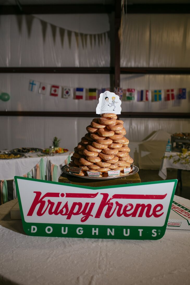 The wedding cake, a tower of Krispy Kreme doughnuts, symbolized the day Ashley and Scott first met at the Krispy Kreme Challenge Race in Raleigh, North Carolina.