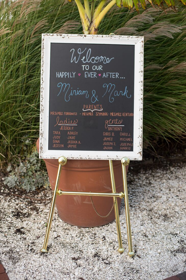 """Our whole home is filled with distressed, rustic pieces of furniture and decorations,"" says Miriam. The couple channeled this  style into their wedding decor. Shabby-chic chalkboard signs, mason jars filled with candlelight and exposed wood vases were used throughout the couple's wedding day."