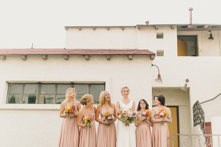 "Laura's five bridesmaids wore the same convertible gown in a blush tone. ""Each woman is so unique and special to me—I wanted them to feel comfortable and be able to be themselves too,"" Laura says."