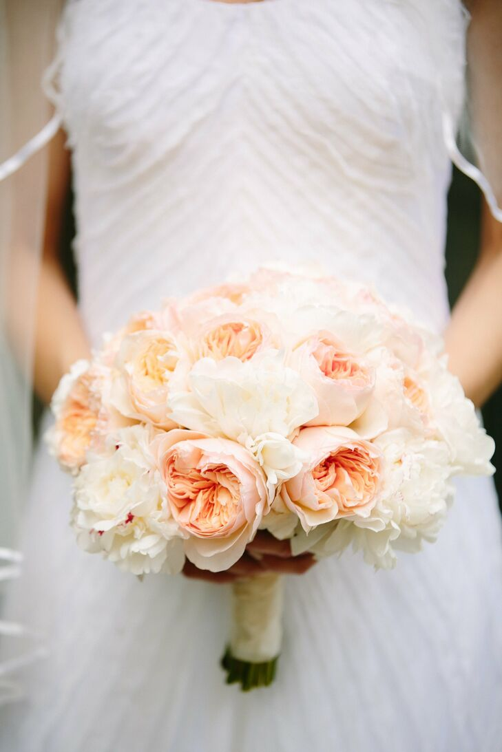 Lush peonies and garden roses made up Carey's soft pink and white bouquet.