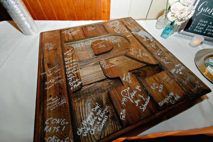 "The guest book was made from recycled wooden pallets. ""We wanted to be able to display something in our home from the wedding day, and this was the perfect way to remember our wedding and our guests,"" the bride says."