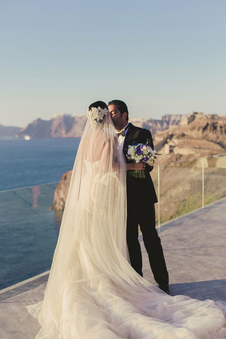 Mariam's dress and veil were designed specially for her by her sister and wedding designer Yasmine Yeya.