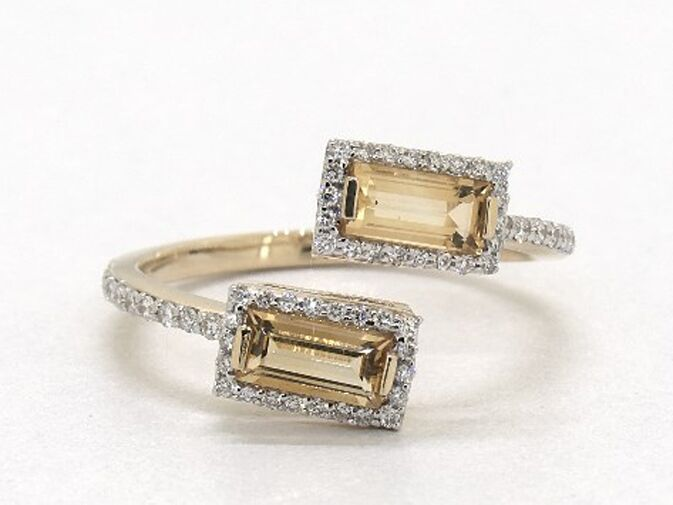 Emerald-cut citrine and diamond halo bypass engagement ring
