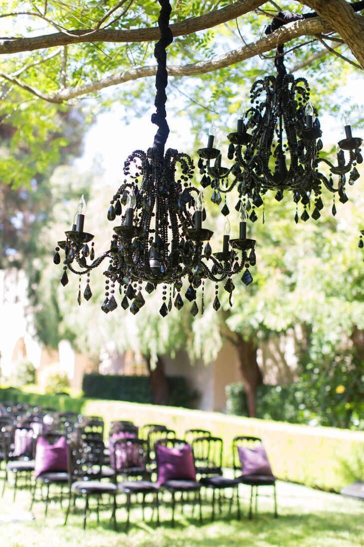 Stefania and Derek exchanged vows under a jacaranda tree that was decorated with Gothic-inspired black chandeliers.
