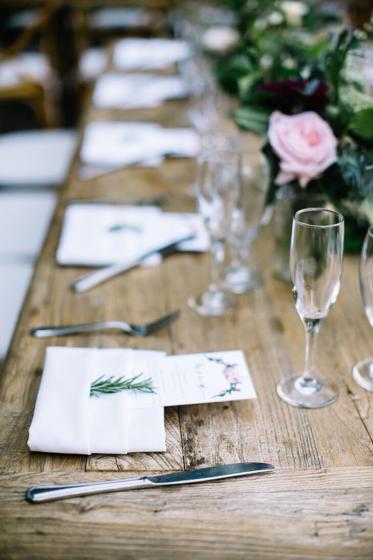 Each rustic farm table was topped with assorted glassware, airy flowers and lush greens.