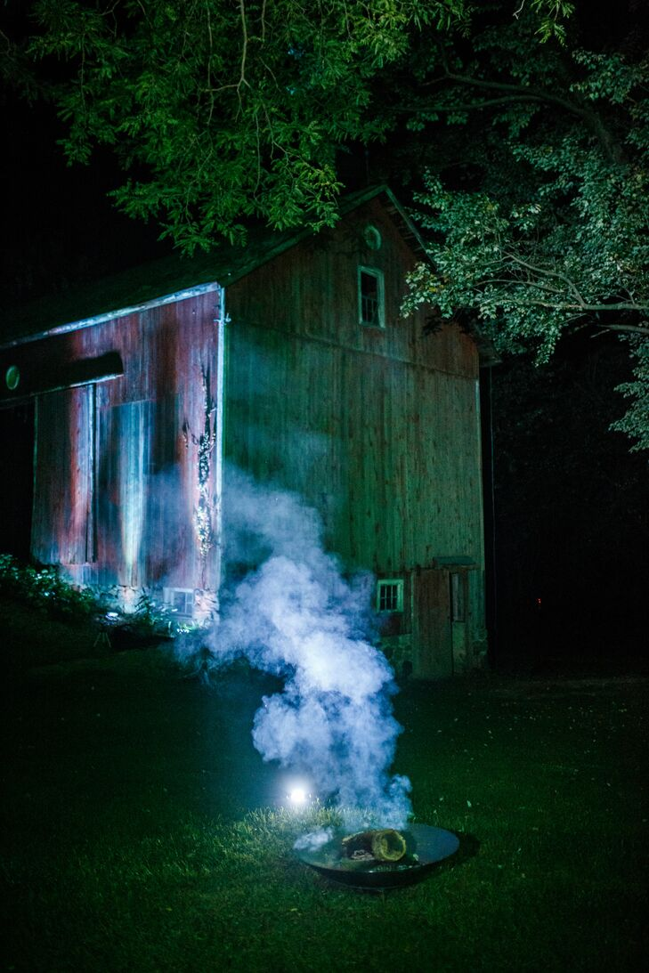 The farmhouse looked stunning at night with soft blue underlighting that helped guests find their way to the dance floor. Several carefully-placed stainless steel firebowls were used for both their ethereal smoke and for keeping mosquitos at bay.
