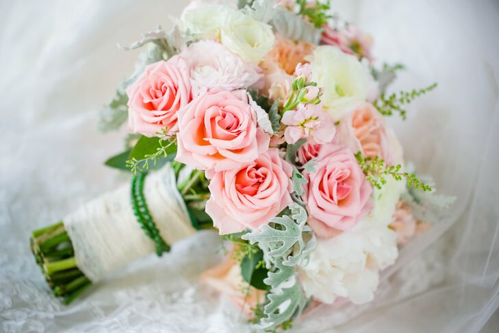 "Sticking to a simple yet elegant theme, Haley's bouquet was a mix of roses, garden roses and dusty miller. ""It was a very light color scheme that tied in perfectly to the rest of the decor,"" she says. Haley wrapped her mother-in-law's jade necklace around the stems as her ""something borrowed."""
