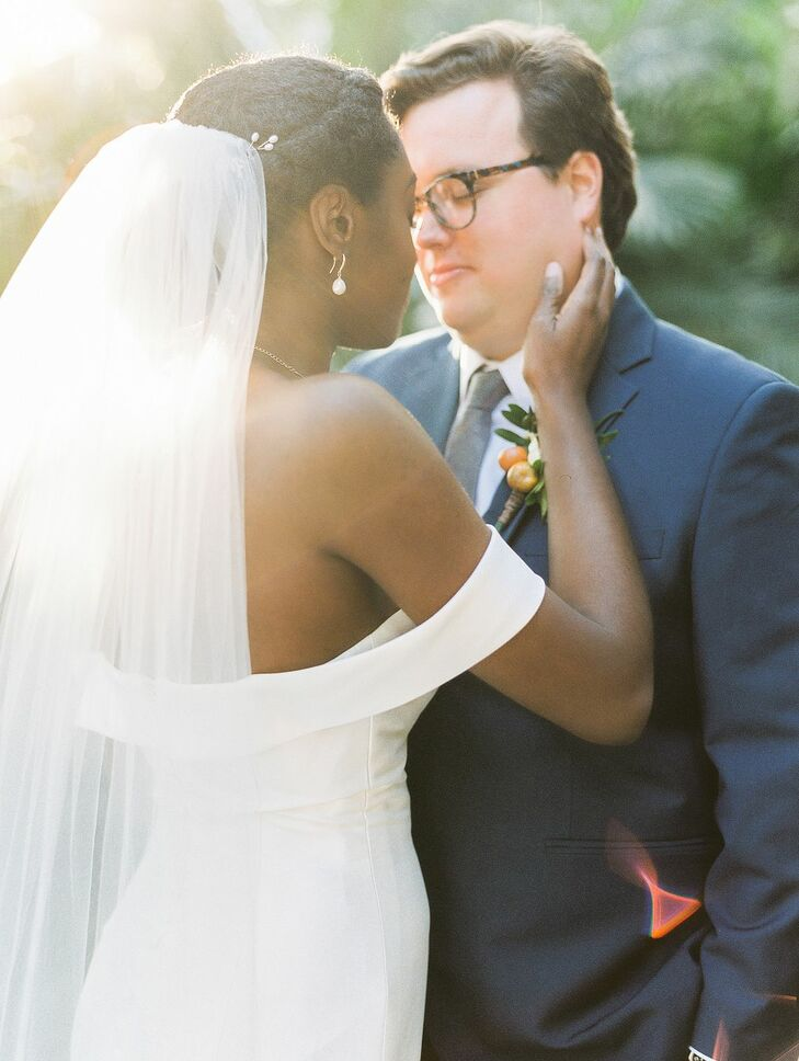 Couple Shares Embrace During Wedding at Tavares Pavilion on the Lake in Florida
